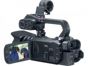 Canon XA20 HD Camcorder Back, 3/4 view, LCD folded out, with handle