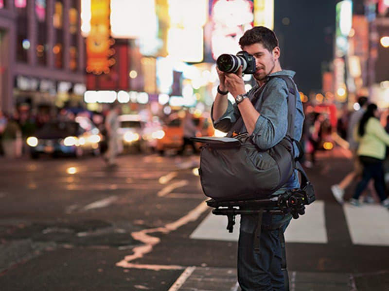 photographer with camcorder case or bag